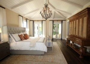 A luxury modern bedroom with antique pieces