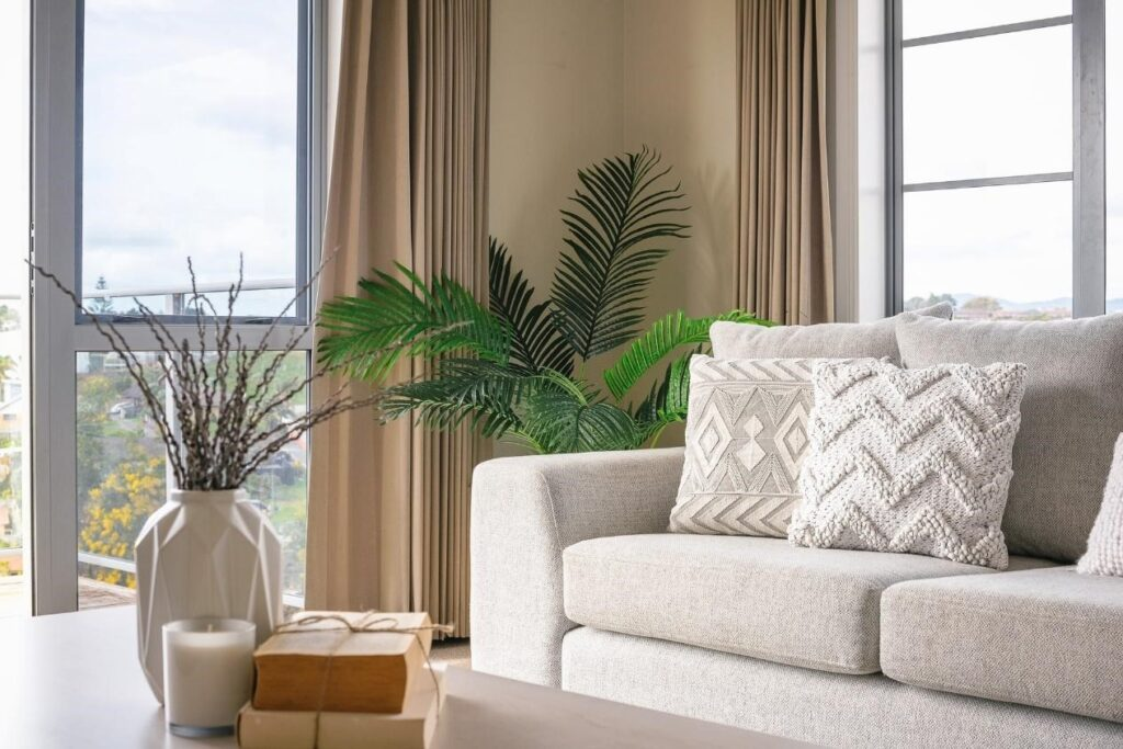A neutral-colored living room overlooking the ocean